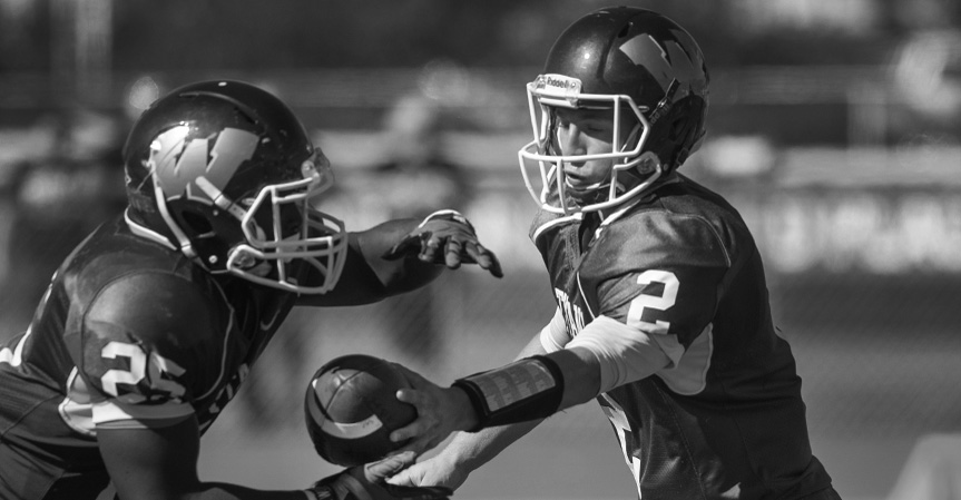 Titan+football+secures+first+conference+win+at+Millikin