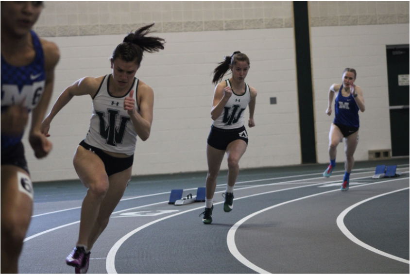 Bendery and Smith come out of their blocks in the 200m dash where they placed first and second, respectively.  Photo: Samira Kassem