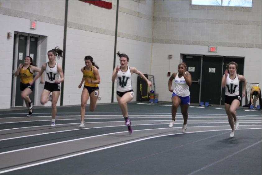 Sophomore Addison Bendery (center) looks to the finish line in the 60m sprint.  Photo: Liam Owens