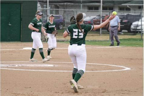 Colleen Palczynski throwing the ball around the horn after completing the out at first Photo: Illinois Wesleyan University