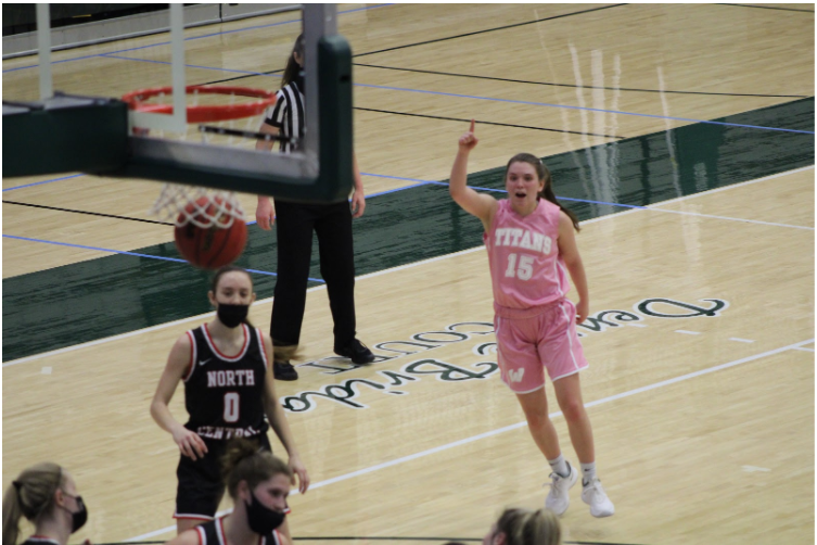 Junior Brooke Lansford swishing a three to put the Titans up at the end of the first half Photo: Isabel Sperry