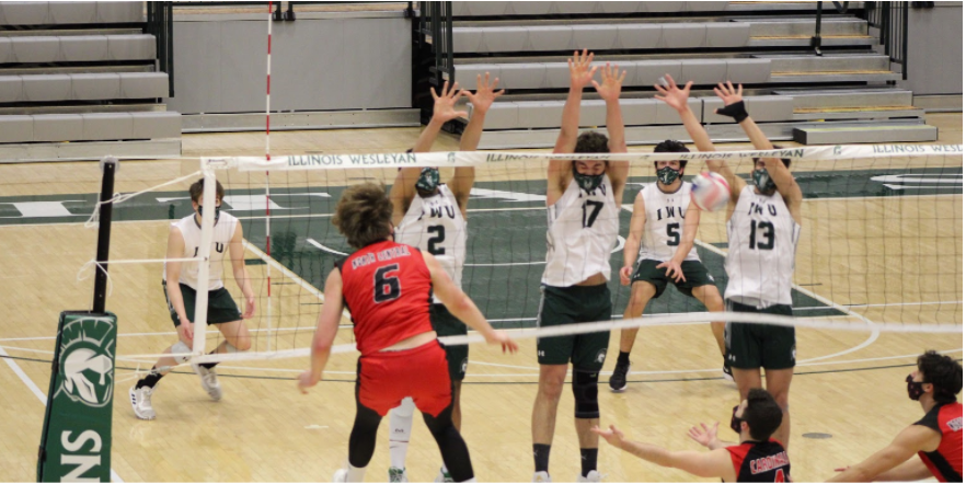 The Titan men's volleyball team during their winning set.  Photos: Katie Fata
