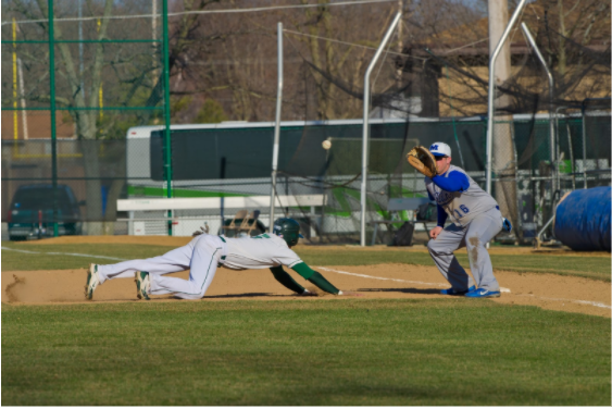 IWU player diving back into the base against Millikin Photo: Illinois Wesleyan