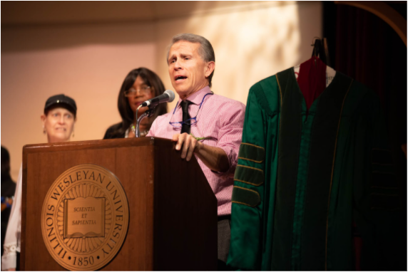 Renner speaking at the annual MLK Teach In hosted by IWU.  Photo: Illinois Wesleyan University