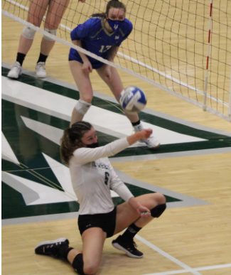 Junior Madi Corey attempting a dig Photo: Isabel Sperry
