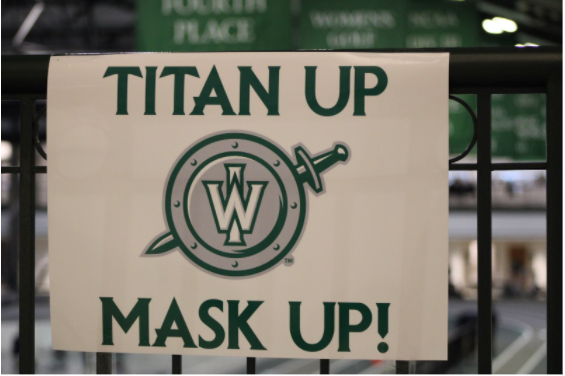 Signs hanging around Shirk Center and other athletic venues urge Titans to mask up.  Photo: Samira Kassem