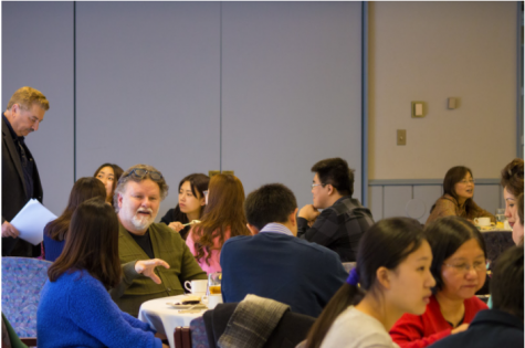 Professor of Anthropology Chuck Springwood visiting with students at an event on campus.  Photo: Illinois Wesleyan University