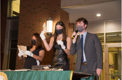 Caption: Student senate presents the contents of the capsule.