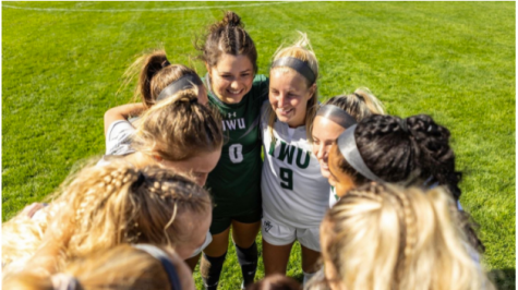 Photo: IWU Sports Seniors Maria Fields (#0) and Caelyn Steffens (#9) celebrate alongside the Titans after their Senior Day victory against Augustana.